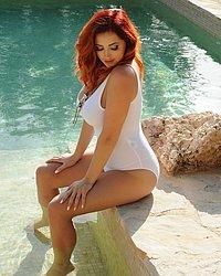 Lucy v in white bodysuit in pool.